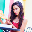 Young Woman Eating big pizza — Stock Photo