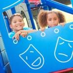 Little Children Looking Through Playhouse Window — Stock Photo #30430563