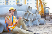 Young construction worker on cell phone — Foto de Stock