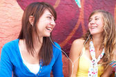 Female Friends Listening Music — Stock Photo