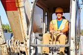 Portrait of young construction worker driving forklift — Stock Photo