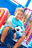 Little Boy With Soccer Ball Sitting In Playhouse — Stock Photo
