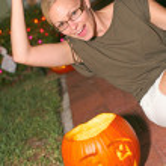 Playful Woman With Halloween Pumpkin — Stock Photo #30730563