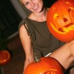 Woman Sitting With Jack-o-Lantern — Stock Photo #30730585