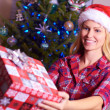 Christmas Woman Giving Gift — Stockfoto