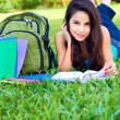 Young Woman Reading Book On Grass — Stock Photo