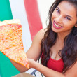 Young Woman Showing Large Slice of Pizza — Stock Photo