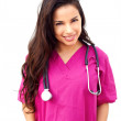 Stock Photo: Young Female Doctor With Hands In Pockets