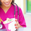 Stock Photo: Female Doctor Having Frozen Yogurt