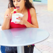 Stock Photo: Young WomEating Frozen Yogurt