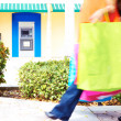 Shopping bags with ATM machine in background. — Stock Photo