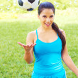 Beautiful woman with soccer ball outdoors — Stock Photo