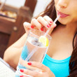 Foto Stock: Hispanic Female Drinking Water