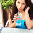 Hispanic Female Drinking Water — Stockfoto