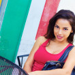 Young hispanic woman sitting at sidewalk cafe — Stock Photo