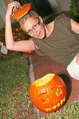 Playful Woman With Halloween Pumpkin — Stock Photo