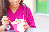 Female Doctor Having Frozen Yogurt — Stock Photo