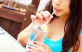 Hispanic Female Drinking Water — Stock Photo