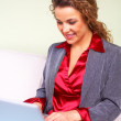 Beautiful business woman holding laptop — Stock Photo