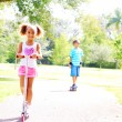 Boy and girl playing in the park — Stock Photo
