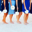 Bridesmaids with bouquets at the beach — Stock Photo