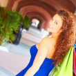 Beautiful smiling young woman with shopping bags. — Stock Photo
