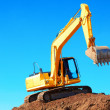 Excavation Machine On Heap Of Soil — Stock Photo #32941445