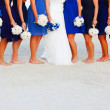 Bride and her friends at the beach with bouquets — Stock Photo
