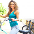 Happy Female Taking A Break On Boardwalk With Bicycle — Stock Photo