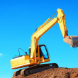 Yellow Excavation Machine On Heap Of Soil — Stock Photo #32941505