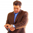 Businessman looking at the time — Stock Photo