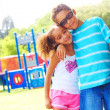 Little girl and boy at park — Stock Photo