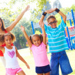 Four children in the park — Stock Photo