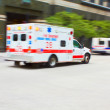 Ambulance to the rescue — Stock Photo