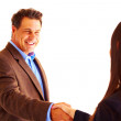 Two businesspeople shaking hands — Stockfoto