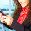 Curly girl with mobile phone — Stock Photo #32941649