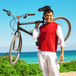 Hispanic male holding up mountain bike — Stock Photo