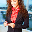 Curly girl with mobile phone — Stock Photo