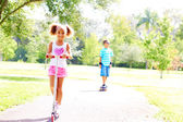Boy and girl playing in the park — Foto Stock