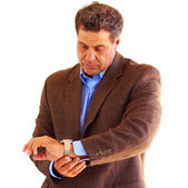 Businessman looking at the time — Stockfoto