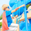 Boy dressed as superhero on the playground — Stock Photo