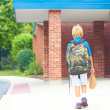 Schoolboy goes to school — Stockfoto