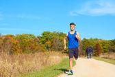 Handsome man jogging — Stock Photo