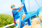 Boy dressed as superhero on the playground — 图库照片