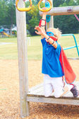 Boy dressed as superhero on the playground — Стоковое фото