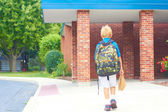 Schoolboy goes to school — Stock Photo