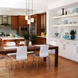 Modern kitchen and dining area - Stock Photo