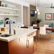 Modern kitchen with sitting and dining area - Stock Photo