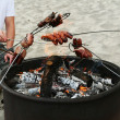 Barbeque on the beach - Stock Photo