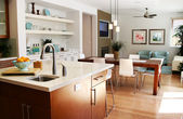 Modern kitchen with sitting and dining area — ストック写真